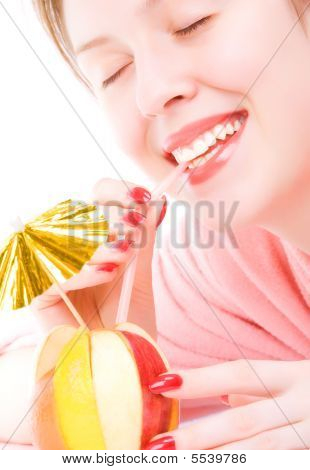 Young Woman Drinking Fruit Mix Coctail