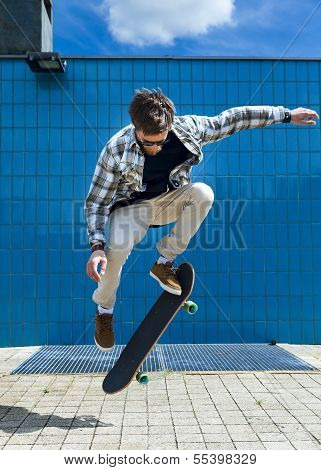 Skateboarder jumping in the city