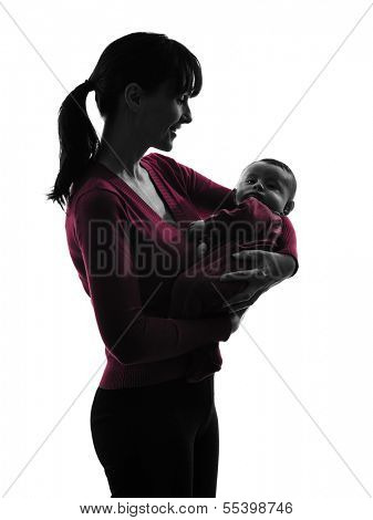 one caucasian woman holding baby silhouette on white background