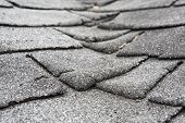 stock photo of shingles  - Old composite  roof with damage - JPG