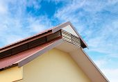 stock photo of gable-roof  - the gable roof against a blue sky - JPG