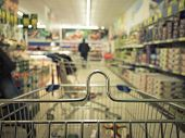 picture of trolley  - View from shopping cart trolley basket at supermarket self - JPG