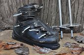 image of ski boots  - old ski boots in a rustic wooden setting - JPG