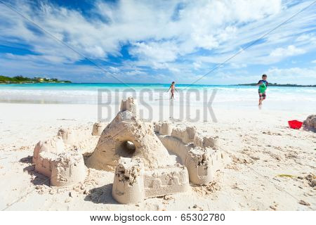 Sandcastle at tropical white sand beach