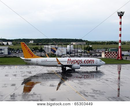 BUCHAREST, ROMANIA - MAY 15, 2014:  A Pegasus Airlines plane on the tarmac in Bucharest, Romania, on Thursday, May 15, 2014. Pegasus is a Turkish low-cost airline.