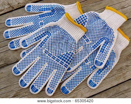 garden gloves on wooden background