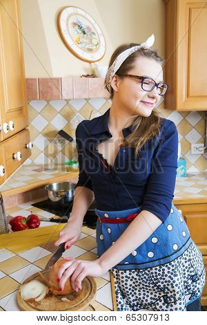 Woman At Sexy Suit Cutting Onion