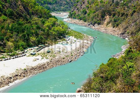 Holy Ganges river flows in a valley, India