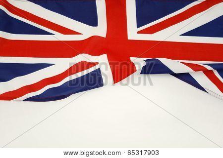 Closeup of Union Jack flag on plain background