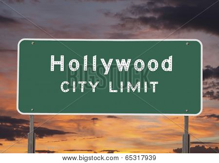 Hollywood city limits sign with sunset sky.