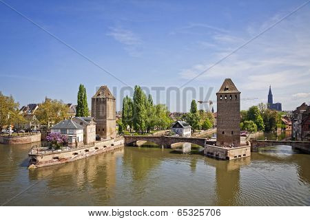 Strasbourg City, Alsace Province, France. View From Barrage Vauban To Medieval Bridge Ponts Couverts