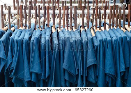 Rows Of Clothes And Wood Coat Hanger