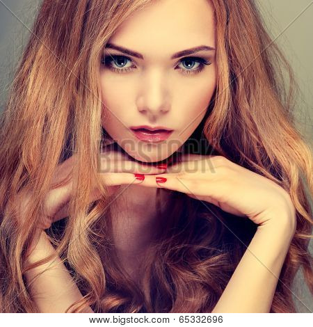 Beautiful girl, isolated on a light - grey background, emotions, cosmetics