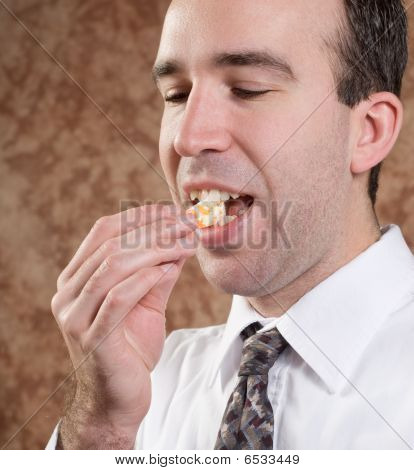 Business Man Eating Orange