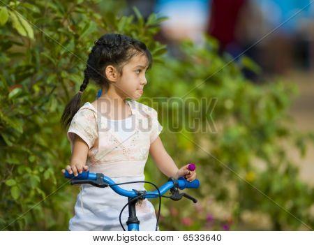 Cute Girl On Her Bike