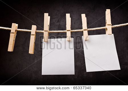 Two Blank Paper Notes Hanging On Rope With Clothes Pins