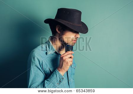 Cowboy Shaving With Electric Shaver