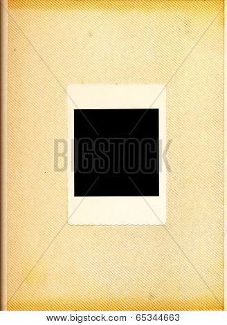 Vintage photo album - old, yellowed page of an old photo album with one big photo frame