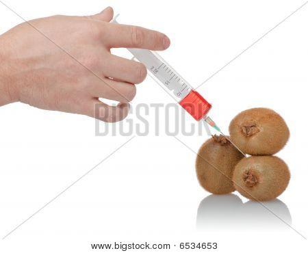 Hand Holds The Syringe On Kiwi