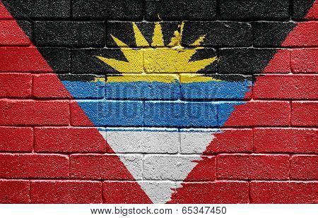 Flag of Antigua and Barbuda painted onto a grunge brick wall
