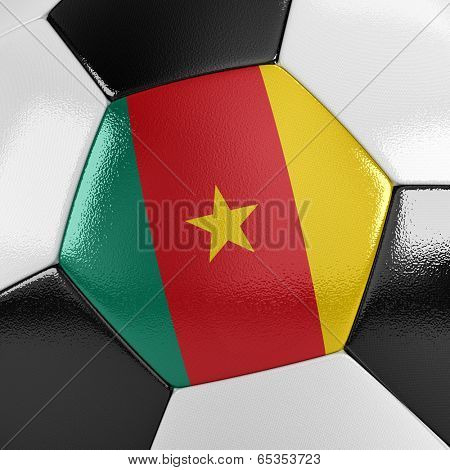 Close up view of a soccer ball with the Cameroonian flag on it
