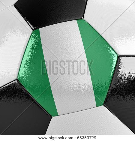 Close up view of a soccer ball with the Nigerian flag on it