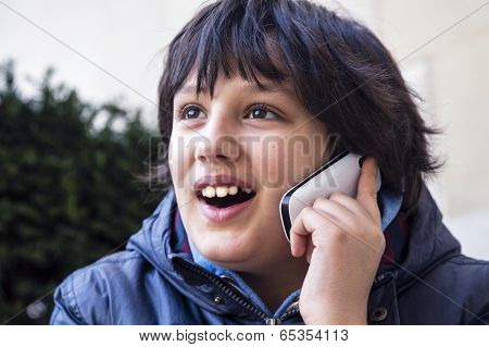 Boy Laughing And Talking On Cell Phone