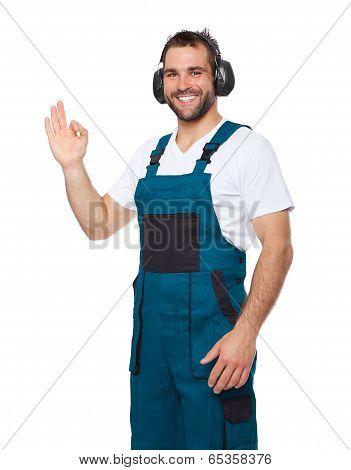 Smiling Worker In Green Uniform With Protective Earphones
