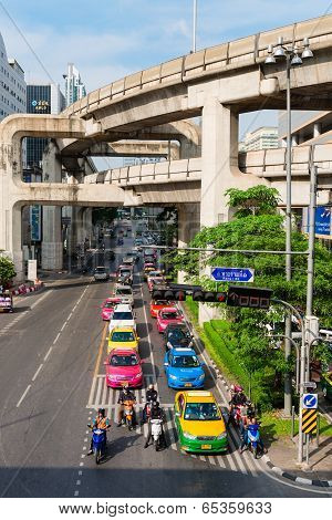 Multilevel Bangkok With Traffic On Street And Skytrain Tracks