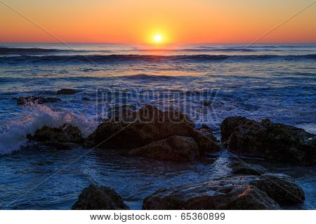 Sunrise On Rocky Beach