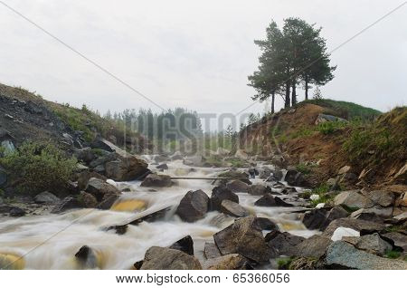 The Mountain River In A Fog