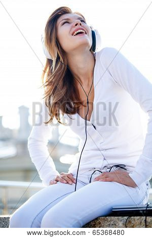 Captivating young girl listens to music through headphones