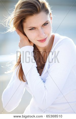 Beautiful woman touches her hair