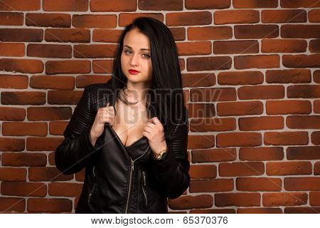 Pretty sexy brunette woman in leather jacket