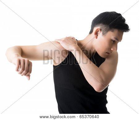 Asian young man with shoulder pain, closeup portrait.