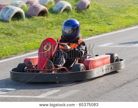 The child moves directly on a go-cart to carting club