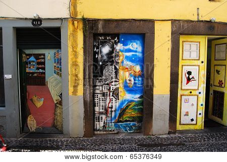 FUNCHAL- APRIL 30, 2014: Graffiti at a door of a house in the street of Santa Maria. Part of