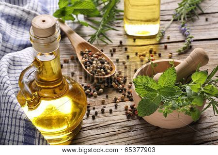 herbs and oil on wooden table
