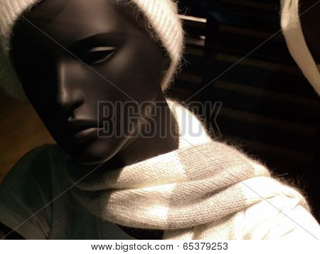 Mannequin wearing muffler in a clothing store