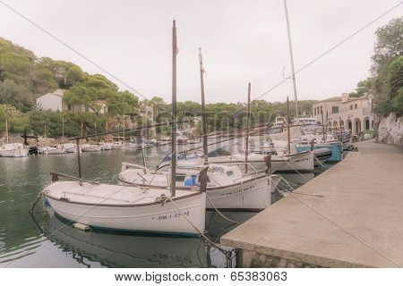 Small Boats Moored In Harbor