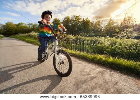 Riding a bicycle for the first time on a country road concept for healthy lifestyle, exercising and road safety