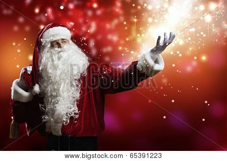 Santa Clause with gift bag behind shoulders