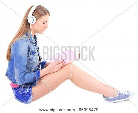 Conceptual image of  audio book.Beautiful girl with book and headphones, isolated on white