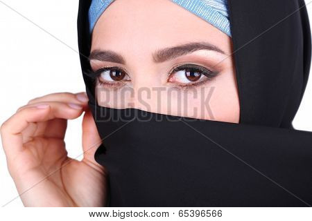 Beautiful muslim arabic woman in paranja on grey background