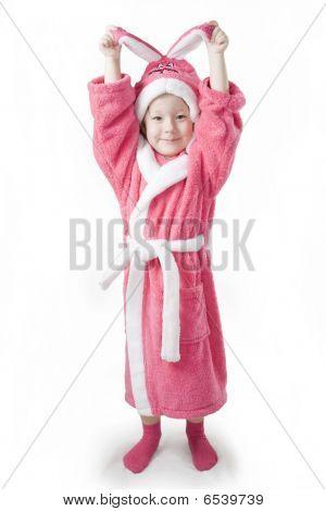 Small Girl Sittingin The Pink Bathrobe Of Bunny