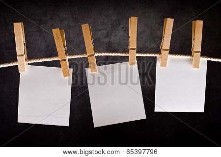 Three Blank Paper Notes Hanging On Rope With Clothes Pins