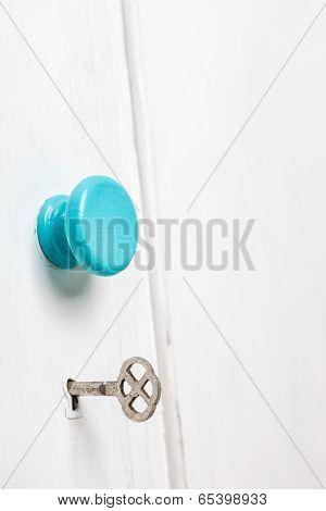 Closeup Of An Old Door Wardrobe Knob And Key Hole.