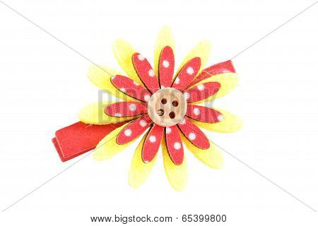 Red And Yellow Of Artificial Flower Hairpin Isolated On White.