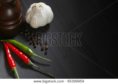 Spicy food on black table, italian cuisine concept