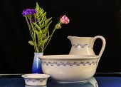 stock photo of wash-basin  - Antique Wash Basin with matching water pitcher and soap dish on glass - JPG